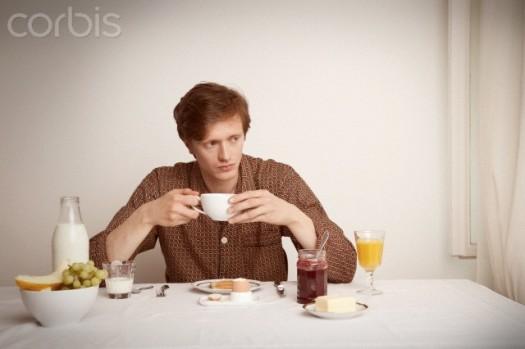 Man having breakfast alone